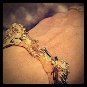 Gold tone 🐎 head bracelet